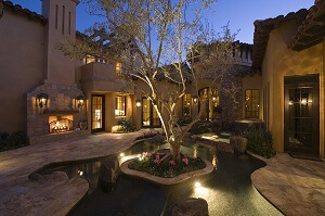 Beautiful outdoor living space with water feature
